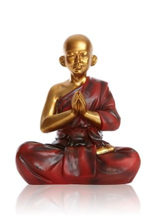 A religious spiritual golden monk statue praying over white Stock Photo - 6027414