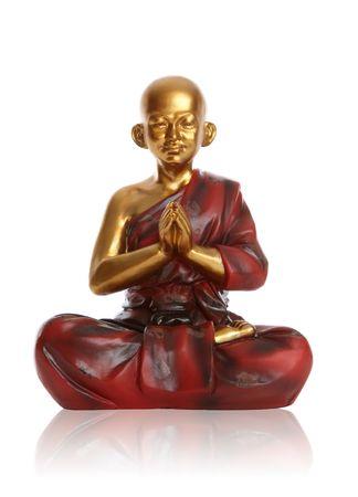 A religious spiritual golden monk statue praying over white Stock Photo - 6027414