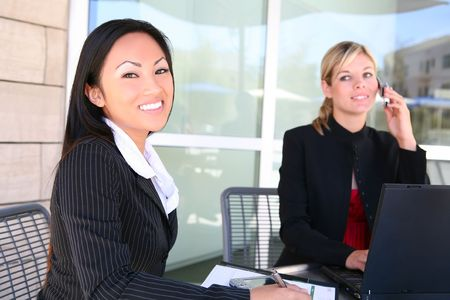 asian office lady: Attractive, young, diverse business woman team at office working