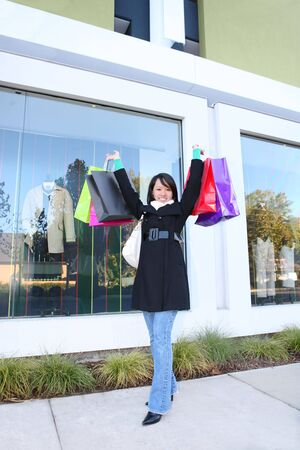 A pretty woman shopping with colorful bags walking to the next store Stock Photo - 6038700