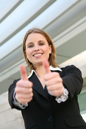 A young blonde business woman with her thumbs up Stock Photo - 6038695
