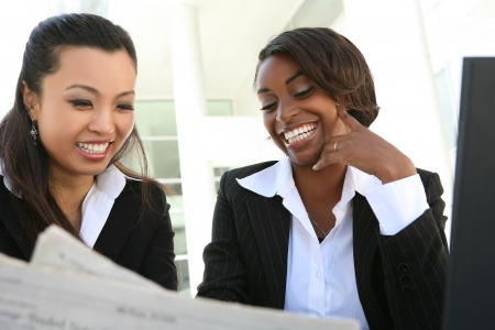 working at office: An attractive women business team working at office
