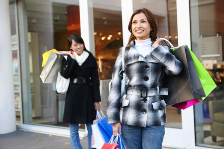 A pretty woman shopping with colorful bags walking to the next store Stock Photo - 6076536