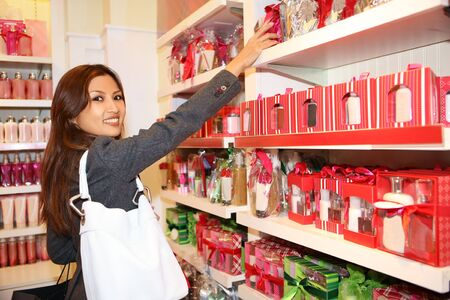 beauty shop: A pretty asian woman shopping for the holidays
