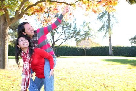 Pretty young asian girls in the park during autumn Stock Photo - 6076543