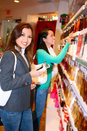 store interior: A pretty asian woman shopping for the holidays