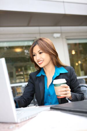 A pretty asian business woman working on her laptop computer Stock Photo - 6099025