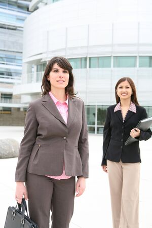company: Pretty Business Women walking to work at the office building Stock Photo