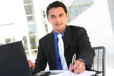 Handsome Latino Business Man at Office Working Stock Photo