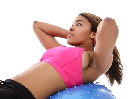 leisure wear: A pretty african american woman exercising isolated over white