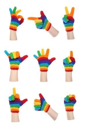 Nine hand gestures with rainbow gloves: success, gun, point, peace, fist; thumbs up, etc Archivio Fotografico