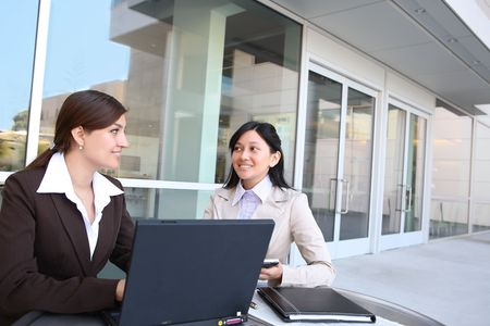 electronic commerce: A women business team at their company office building