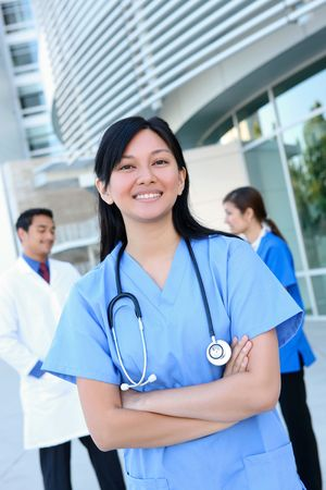 A happy and successful medical man and woman team outside hospital building Stock Photo - 6283167