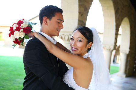 Prettyl bride and handsome groom at church during wedding