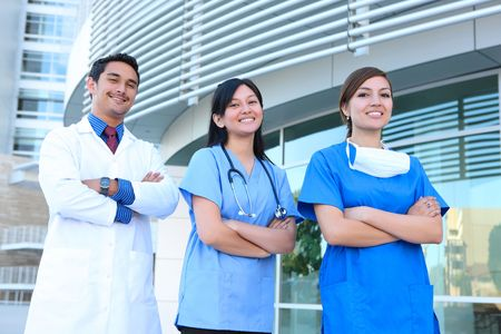 A successful man and woman medical team outside hospital building Stock Photo