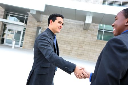 africanamerican: An attractive, diverse business man team shaking hands Stock Photo