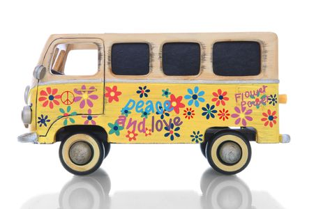 An old vintage hippie peace and love van over a white background Stock Photo - 6385664