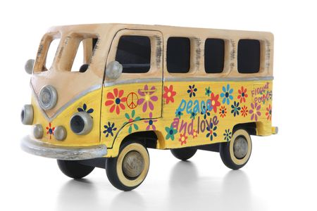 An old vintage hippie peace and love van over a white background photo
