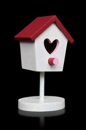 A Valentines Day love birdhouse over black background