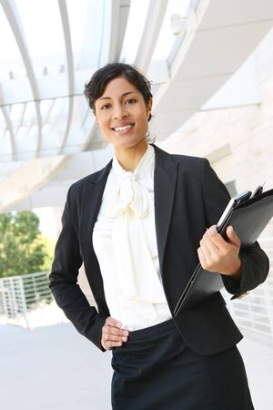 A happy african american business woman at her office building photo