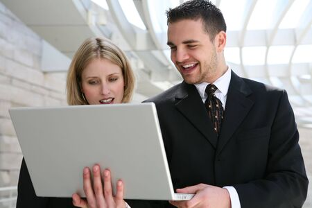 Young man and woman business team with computer at company photo