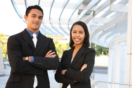 An attractive, diverse man and woman business team at their company office building photo