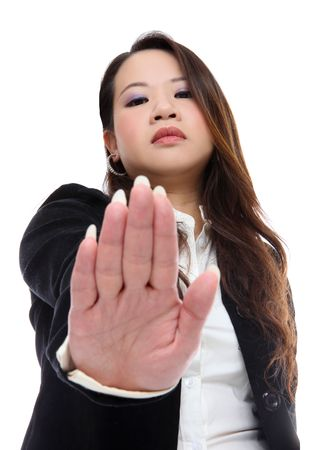 disgusted: An angry asian business woman signaling to stop isolated Stock Photo