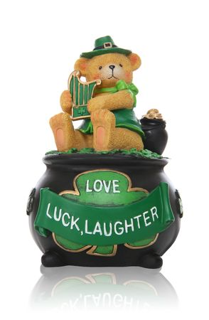 A bear with harp sitting on pot of gold for Saint Patricks Day holiday Stock Photo - 6450825