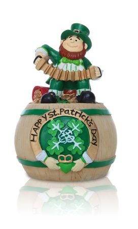 A Leprechaun with accordion sitting on pot of gold for Saint Patricks Day Stock Photo - 6483739