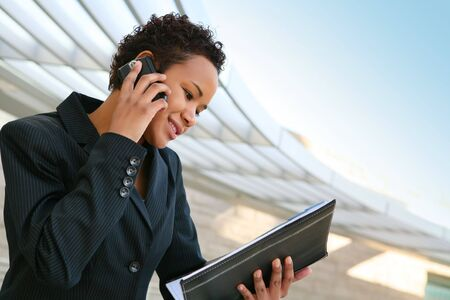 american sexy girl: A pretty african american business woman at her company on the phone