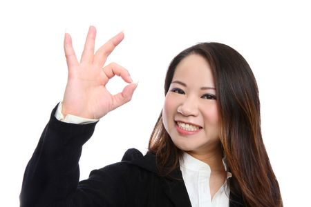Pretty Asian Woman signaling success isolated over white Stock Photo - 6472444