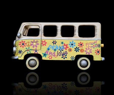 An old vintage hippie peace and love van over a black background photo
