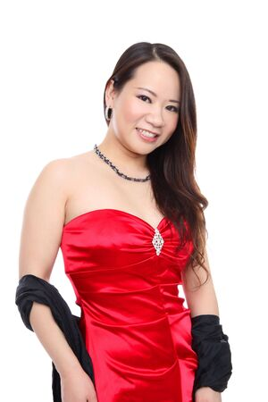A young beautiful Asian woman in red dress isolated over white Stock Photo - 6540585