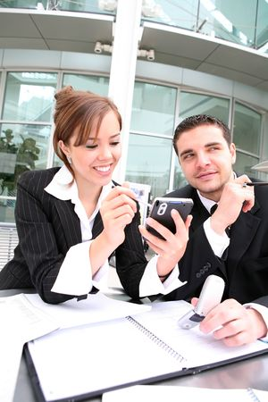 An attractive man and woman business team working at office photo