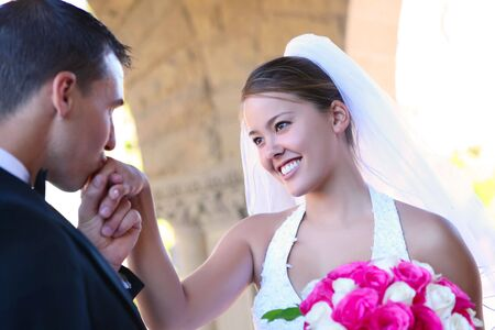 A beautiful woman bride and handsome man groom at church during wedding Stock Photo - 6553940