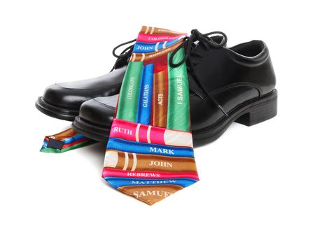 A business man's shoes and bible religion books tie over white background Stock Photo - 6598029
