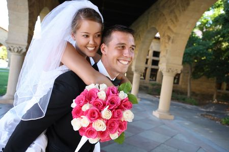 interracial marriage: A beautiful woman bride and handsome man groom at church during wedding