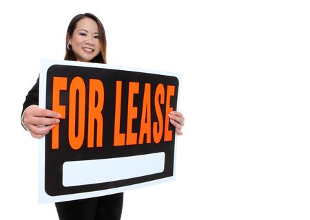 A cute young asian woman holding a lease sign isolated over white Reklamní fotografie