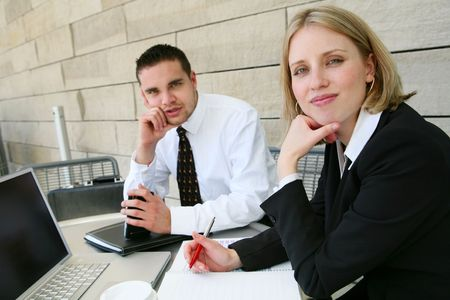 Attractive young man and woman business team at office building photo