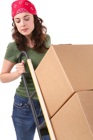 A pretty woman moving and shipping using a two wheel push cart photo
