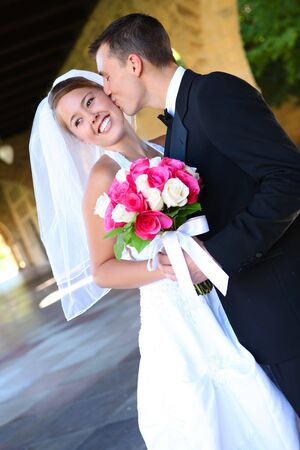 A beautiful woman bride and handsome man groom at church during wedding