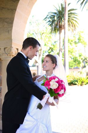 A beautiful woman bride and handsome man groom at church during wedding photo