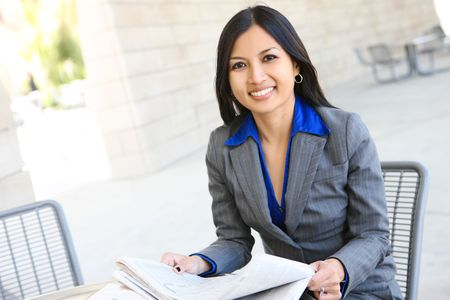 An attractive Indian business woman outside office building Stock Photo - 6719342