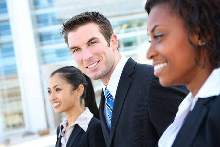 diverse: A diverse attractive man and woman business team at office building