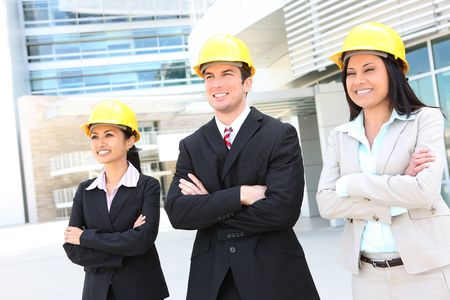female engineer: Successful man and woman construction team at work site