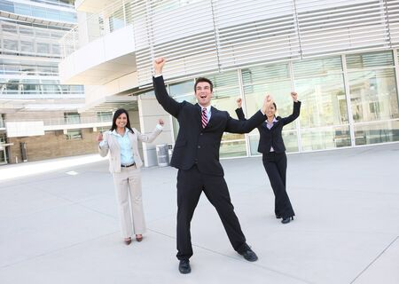 A diverse attractive man and woman business team at office building celebrating photo