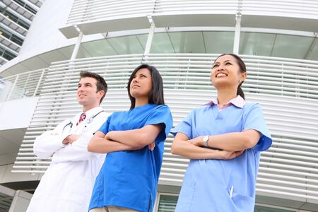 An attractive successful man and woman medical team outside hospital photo
