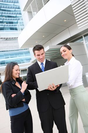 An ethnic  man and woman business team at office building on laptop computer photo