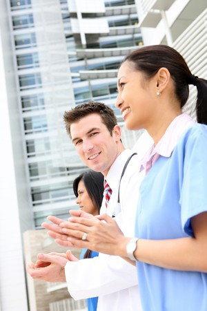An attractive successful man and woman medical team outside hospital Stock Photo - 6936290