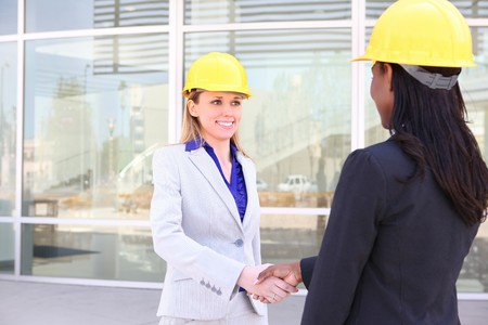An attractive woman architect team on construction site handshake Stock Photo - 6936293